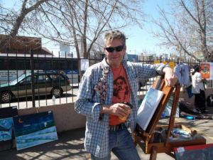 Painter Michael Purcell shown here at the Upper Colfax Root 40 MusicFest.   (photo by Orville Springs)